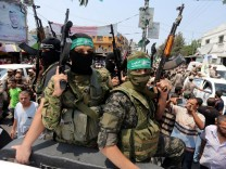 Palestinian Hamas militants attend the funeral of their comrade in Rafah in the southern of Gaza Strip