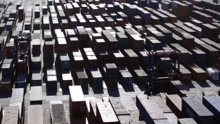 File photo of container transport vehicles move at HHLA Container terminal Burchardkai in Hamburg
