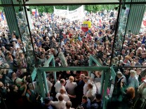 Supreme Court President Malgorzata Gersdorf addresses the supporters and the media before entering the Supreme Court building in Warsaw