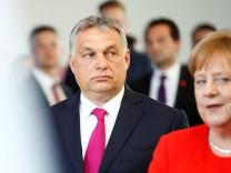 German Chancellor Angela Merkel and Hungarian Prime Minister Viktor Orban arrive talk to the media after a meeting in Berlin