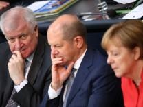 Horst Seehofer, Olaf Scholz und Angela Merkel bei einer Debatte zur Asylpolitik im Bundestag