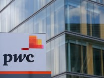 FILE PHOTO: The logo of PwC is seen in front of the local offices building of the company in Luxembourg