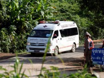 An ambulance believed to be carrying rescued schoolboys leaves from Tham Luang cave complex in the northern province of Chiang Rai