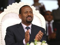 FILE PHOTO: Ethiopia's Prime Minister Abiy Ahmed attends a rally during his visit to Ambo in the Oromiya region