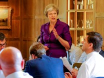 Britain's Prime Minister Theresa May commences a meeting with her cabinet to discuss the government's Brexit plans at Chequers, the Prime Minister's official country residence, near Aylesbury