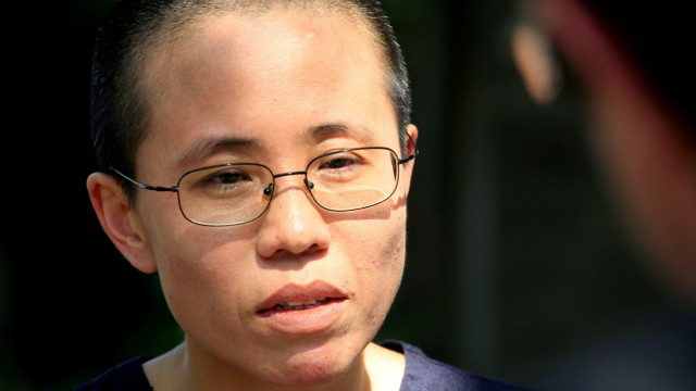 FILE PHOTO - Liu Xia, wife of veteran Chinese pro-democracy activist Liu Xiaobo, listens to a question during an interview in Beijing