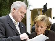 Seehofer und Merkel, dpa