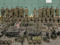 German Bundeswehr armed forces soldiers with the 371st armoured infantry battalion pose for photographers with their equipment in Marienberg