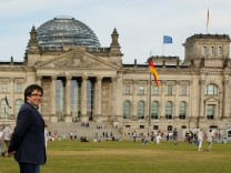 FILE PHOTO: Former Catalan President Carles Puigdemont walks in front of the Bundestag in Berlin