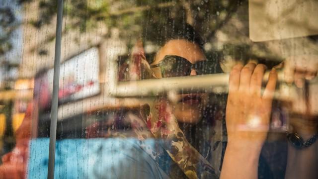Iran: Iranian woman sits on a bus in Tehran