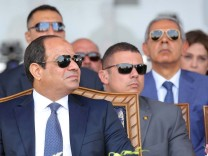 Egyptian President Abdel Fattah al-Sisi attends during the first anniversary of launching the New Suez Canal and the 60th anniversary of nationalizing the Suez Canal in Ismailia