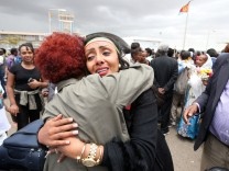 Relatives embrace after meeting at Asmara International Airport