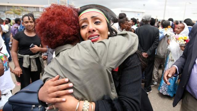 Relatives embrace after meeting at Asmara International Airport
