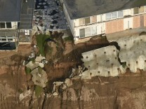 Uninhabitable apartment buildings, in danger of collapsing into the Pacific Ocean, line Esplanade Ave. in Pacifica
