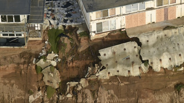 Uninhabitable apartment buildings, in danger of collapsing into the Pacific Ocean, line Esplanade Ave. in Pacifica