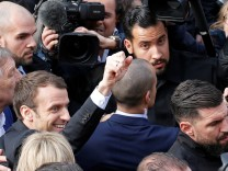 Emmanuel Macron, head of the political movement En Marche ! (or Onwards !) and candidate for the 2017 presidential election, waves as he arrives to visit the birthplace of novelist Alexandre Dumas and to talk about culture in Villers-Cotterets