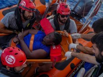 NBA Memphis player Marc Gasol and members of NGO Proactiva Open Arms rescue boat carry African migrant in central Mediterranean Sea