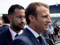 Emmanuel Macron walks ahead of his aide Alexandre Benalla at the end of the Bastille Day military parade in Paris