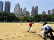 New yorkers play baseball in Central Park in New York