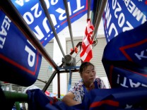 A worker makes flags for U.S. President Donald Trump's 'Keep America Great!' 2020 re-election campaign at Jiahao flag factory in Fuyang