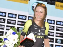 Dutch Annemiek Van Vleuten celebrates on the podium after winning the La Course by Le Tour de Franc