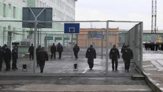Inmates walk inside an enclosure at a high-security male prison camp outside Russia's Siberian city of Krasnoyarsk