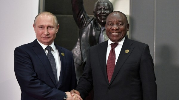 Russia's President Putin shakes hands with South Africa's President Ramaphosa at the BRICS summit in Johannesburg
