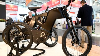FILE PHOTO: Visitors pass an E-Bike at the Hannover Messe, the trade fair in Hanover