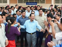 Senate election in Cambodia Cambodian Prime Minister Hun Sen C is surrounded by his supporters in
