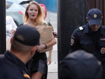Intruders affiliated to anti-Kremlin punk band Pussy Riot, Nikulshina and Kurachyova, who ran onto the pitch during the World Cup final between France and Croatia, walk out of a detention center after leaving 15-day jail in Moscow