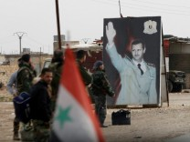 FILE PHOTO: Syrian forces loyal to President Bashar al-Assad hold a checkpoint in Aleppo