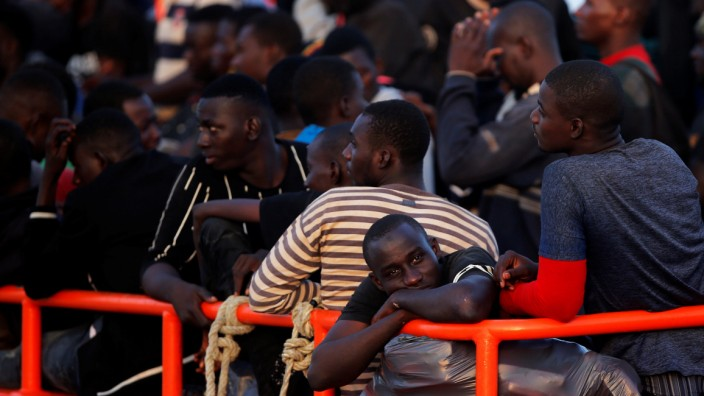 Migrants are seen on a rescue boat as they wait to disembark after arriving at the port of Malaga