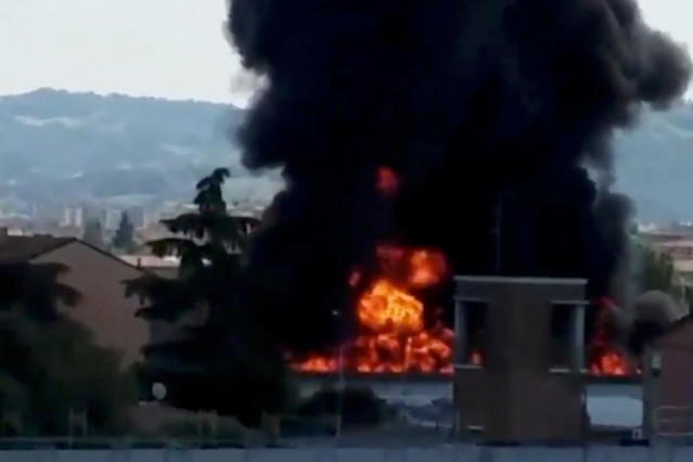 A fire is seen after an accident caused a large explosion at Borgo Panigale, on the outskirts of Bologna
