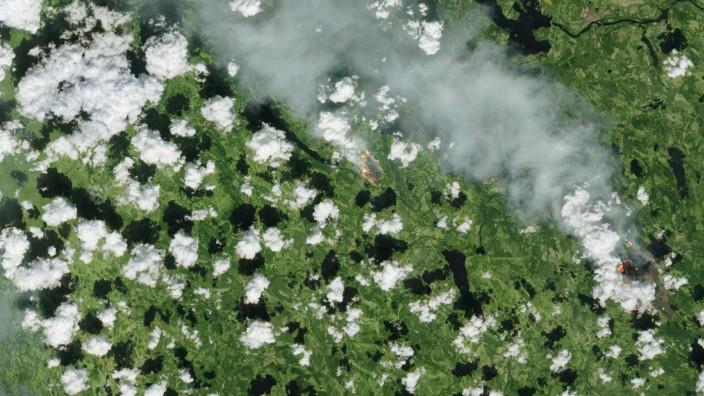 Waldbrände in Skandinavien aus dem All