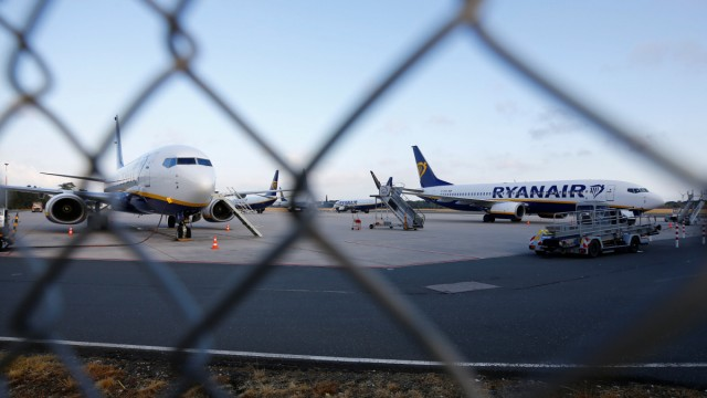 Aircrafts of low-cost airliner Ryanair are seen behind a fence while being parked at the tarmac of Weeze airport near the German-Dutch border during a wider European strike of Ryanair airline crews