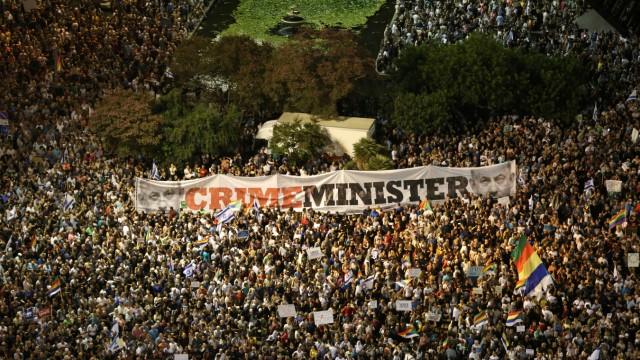 Israelis from the Druze minority together with others take part in a rally to protest against Jewish nation-state law in Rabin square in Tel Aviv