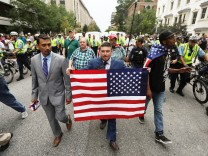 White nationalist leader Jason Kessler marches to participate in a rally marking the one year anniversary of the 2017 Charlottesville âÄ~Unite the RightâÄÖ protests