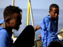 Migrants are seen on board the MV Aquarius, in the Mediterranean Sea, between Malta and Linosa