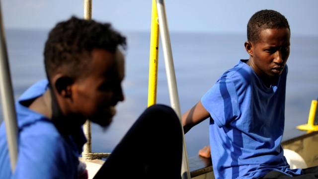 Migrants are seen on board the MV Aquarius, in the Mediterranean Sea, between Malta and Linosa
