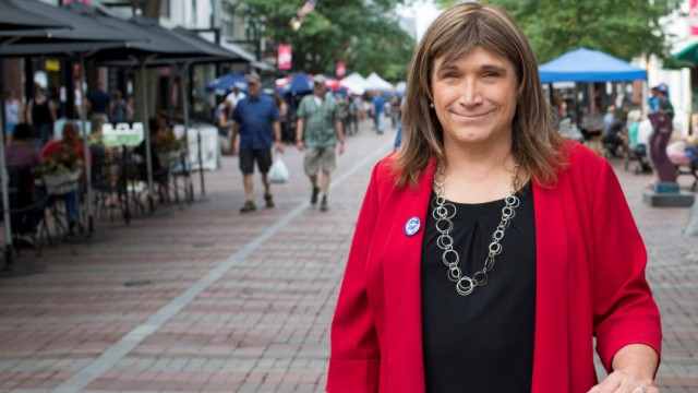 Vermont Democratic Party gubernatorial primary candidate Christine Hallquist, a transgender woman, poses as she campaigns on Church Street in Burlington, Vermont
