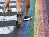 Crosswalks, painted as a rainbow flag, are pictured in the street near the Gay Games village at the Hotel de Ville city hall in Paris