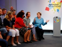 German Chancellor Angela Merkel talks before 'Buergerdialog zur Zukunft Europa's' (Dialogue on Europe's future) in Jena