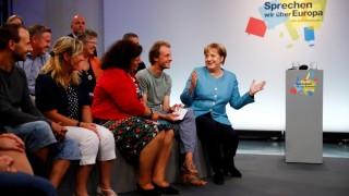 German Chancellor Angela Merkel talks before 'Buergerdialog zur Zukunft Europa's' (Dialogue on Europe's future) in Jena