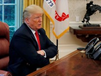 U.S. President Trump answers question as eight devices record him during interview with Reuters in Oval Office of White House in Washington