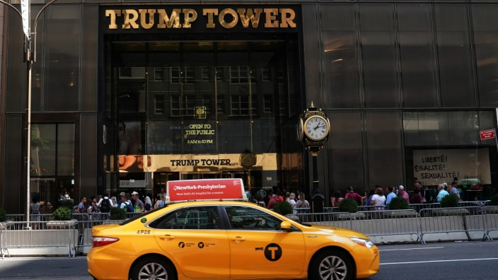 A taxi goes past Trump Tower in New York City