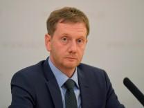 SaxonyâÄÖs state premier Michael Kretschmer addresses a news conference in Dresden