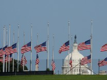 Flags fly at half staff in honor of Senator John McCain (R-AZ) at the Washington Monument in Washington