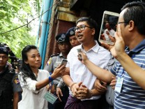 Detained Reuters journalist Wa Lone leaves the court in Yangon