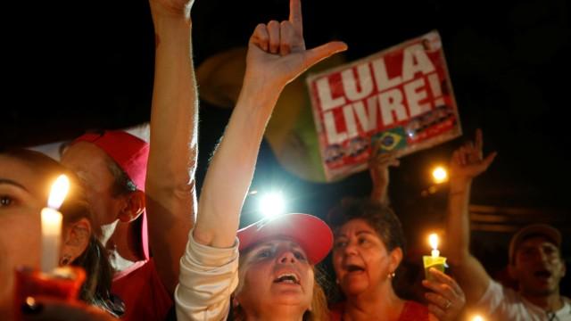 Supporters of former Brazilian president Luiz Inacio Lula da Silva attend a vigil outside the Federal Police Superintendence in Curitiba