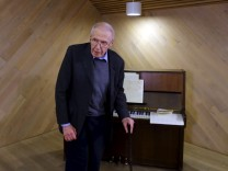 Gyorgy Kurtag, world famous Hungarian composer of classical music and pianist, stands in front of a piano as he celebrates his 90th brithday in Budapest's Music Center